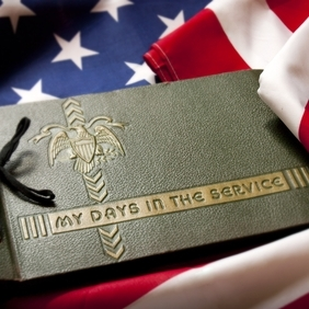 Memorial Day Veteran's Remembrance with Military Service album and flag.
