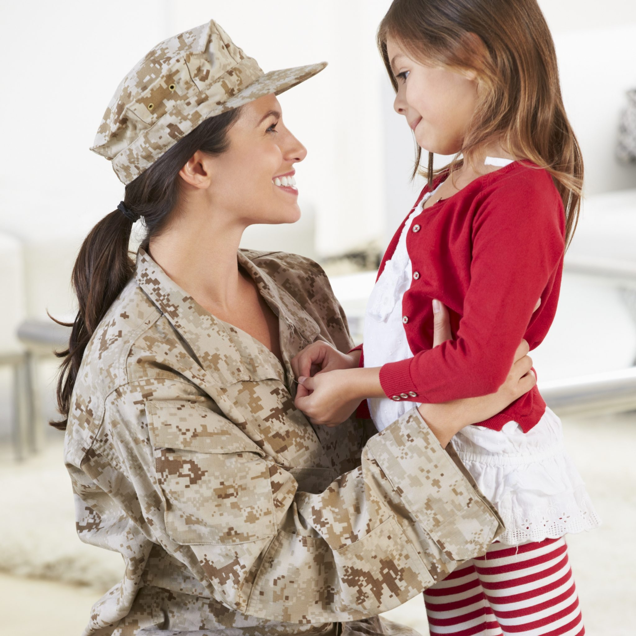 Daughter Greeting Military Mother Home On Leave